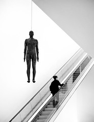 Antony Gormley at the Portrait Gallery (Carolbreeze99) Tags: london bw nationalportraitgallery sculpture anthonygormley suspended statue human people installation art artwork escalator stairs goingup minimal lessismore composition geometric angles antonygormley
