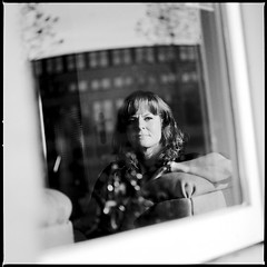 Rianne. Partner at O-Utrecht. (Pim Geerts) Tags: approved rianne 500c045046 planar 120mm neopan acros 100 pimg1781 portret portrait photography zwartwit blackandwhite bw monochrome hasselblad 500c film processed ishootfilm filmisnotdead carl zeiss f4 macro 6x6 medium format middenformaat analoog analog window reflection reflectie ruit raam weerdsingel