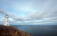 Cape Spear Lighthouse (Karen_Chappell) Tags: lighthouse capespear longexposure nd110 blue clouds newfoundland nfld canada atlanticcanada ocean seascape sea landscape avalonpeninsula atlantic white scenery scenic canonefs1022mm wideangle