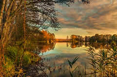 Autumn lake (piotrekfil) Tags: nature landscape water lake reflections clouds sky sunset trees pentax poland piotrfil