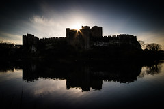 Pembroke Castle (*Hairbear) Tags: stone sun blue silhouette medieval skies winter low water cold moat castle pembroke pembrokeshire clouds