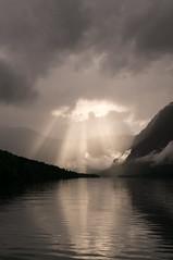Slovenia (Yann OG) Tags: slovenia slovenija slovnie bohinj lac lake cloud nuage rayofsunshine sunlight rayondesoleil sigma30mm montagne mountain badweather mauvaistemps alpesjuliennes julianalps uppercarniola hautecarniole triglav reflet reflection sunray