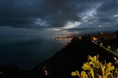 Taormina dai monti domina il mare (mttdlp) Tags: night nightscape d3200 sea seta mare montagna clouds landscape strada lights fichi sicilia sicily