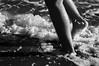 Stomping (Omar Hurtado) Tags: ocean sea bw feet beach water sand legs alameda stomping seafoam