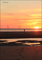 "Sunset - Antony Gormley ""Another Place"" (berylquayle) Tags: orange clouds liverpool canon sand thought power horizon footprints windmills calm 7d windfarm gentle crosby antonygormley provoking anotherplace"