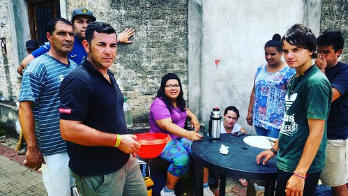 Exequiel Bond, in black shirt, coordinates a group of volunteers cooking lunch for the displaced by the floods in Concordia, Northeastern Argentina. They bring hot meals to neighborhoods where people are afraid of leaving their homes, add they could be lo