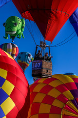 Balloon Fiesta 2016 | Up, Up, and Away | Morning-Ascension, 07:06AM (Facundity) Tags: albuquerqueinternationalballoonfiesta aibf balloonfiesta2016 hotairballoons basket pilot webmillenial colorful albuquerque newmexico sky checkered red vivid vertical frog kermie ef70200mmf4lisusm canon5dmkiv closeup skyward naturallight outdoors outdoorphotography