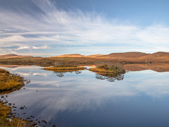 Looking south (Sunshinenshadows) Tags: water trees clouds reflections lochan isleoflewis outerhebrides islands scotland autumncolours gold rust brown yellow