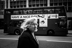 have a nice day (stefanopad82) Tags: london uk woman old looking bus oxfordstreet portraitbw bw black white hair glasses