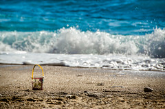 Bucket (Melissa Maples) Tags: ka turkey trkiye asia  nikon d5100   nikkor afs 18200mm f3556g 18200mmf3556g vr kaputa beach mediterranean sea water sand bucket waves ka trkiye    kaputa