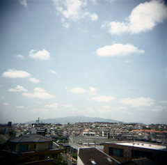 a cloudy reverie (troutfactory) Tags: cityscape view clouds sky  mountrokko rokkomountain  toyonaka  kansai  japan holga square mediumformat fujifilmprofessional400