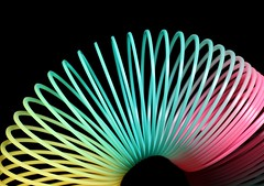 Slinky (Karen_Chappell) Tags: slinky toy plastic black blue pink yellow stilllife pastel product
