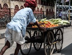 Economy? (simone.tonelli) Tags: india colors vegetables merchant