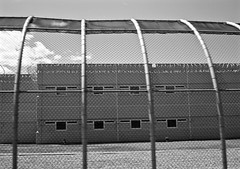 The End of The Line (BlueisCoool) Tags: blackandwhite bw cold fence dark outdoors photography photo flickr foto image outdoor massachusetts sony picture newengland cybershot can creepy prison jail bleak pokey cooler capture joint brig depressing jailhouse penitentiary gao dedhammassachusetts clink slammer behindbars stockade lockup thebighouse correctionalfacility dscw300 norfolkcountyjail thenorfolkcountycorrectionalcenter