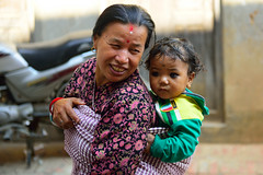 Proud Grandmother (jfusion61) Tags: nepal portrait woman holiday nikon child grandmother smiles blessing d750 kathmandu 2470mm kirtipur