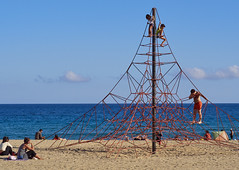 Climbing Euclid (peter.a.klein (Boulanger-Croissant)) Tags: barcelona sea sky men geometric beach boys clouds spain sand women geometry rope pole climbing barceloneta lattice junglegym parabola hypebola