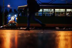 91/365 Keeping Pace (ewitsoe) Tags: street city autumn urban reflection wet female 35mm lights nikon legs body pavement tram poland pedestrian transit poznan lowdof d80 ewitsoe erikwitsoe
