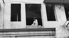 Window Watching (Ewa Graf) Tags: poverty new city bw india portraits delhi slums