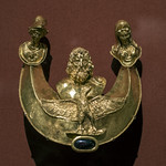 Roman gold pectoral with relief representations of Jupiter, Juno and Minerva thumbnail