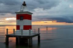 IL FARO (Franzxx70) Tags: faro lighthouse mare sea alba dawn clouds nuvole yellow morning mattina serenita serenity orizzonte horizon sky cielo landscape paesaggio