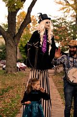 The Puppet (Kat Hatt) Tags: skeletonpark kingston ontario halloween puppet stilts banjo kathatt smiling parade
