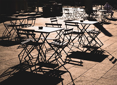 Deserted terrace cafe (chrisk8800) Tags: terracecafeteria tables chairs shadows againstthelight outdoor sunlight lines geometric barcelona