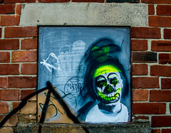 smudged clown (PDKImages) Tags: sheffield sheffieldart sheffieldstreetart streetart art beauty girl cat baby newlife foetus doll gothi horror walls cracked eyes building gorillaz love clown