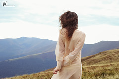 woman in mountains (jn_photography_lviv) Tags: autumn summer mountains nature girl grass weather silhouette forest outdoors beige loneliness dress wind spin chiffon dramatic windy thesky ukraine calm depression mysterious translucent thin redhair fragile curlyhair carpathians youngwoman coolness onthestreet darkhair longsleeves wavinghair yellowgrass carpathianmountains lookintothedistance viewfromtheback spikelets ukrainiancarpathians treatmentofdepression transparentfabric