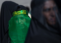 iranian shiite muslim women mourning imam hussein on the day of tasua with their faces covered by a veil, Lorestan Province, Khorramabad, Iran (Eric Lafforgue) Tags: people green face horizontal mystery female religious outdoors persian clothing women veil mourning iran muslim islam traditional text religion middleeast headshot womenonly celebration hidden covered mysterious shia ritual muharram ashura calligraphy script tradition niqab 2people twopeople hussein burqa iman shiite ashoura hussain mourner persiangulfstates   16321 tasua husayn colourimage  iro shiism arabicalphabet khorramabad  tasoua westernasia  lorestanprovince chehelmenbari