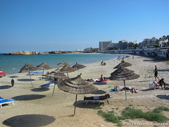 An Innocent Beach in Monastir (David J. Greer) Tags: ocean blue sea sky people sun beach water sunshine umbrella mediterranean tunisia innocent sunny umbrellas monastir