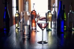 the tasting (*Chris van Dolleweerd*) Tags: wine bottles glass wineglass winebottle dof colors liquid wijn fles glas naturallight rose reflections chrisvandolleweerd series stilllife 50mm table