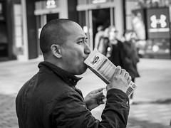 Got Soya? (Leanne Boulton) Tags: monochrome people depthoffield urban street candid closeup portrait portraiture profile streetphotography candidstreetphotography candidportrait eyecontact candideyecontact streetlife man male face facial expression eyes look emotion feeling drinking milk soya substitute healthy rimlighting reflection tone texture detail bokeh natural sunlight light shade shadow city scene human life living humanity society culture canon 7d 50mm black white blackwhite bw mono blackandwhite glasgow scotland uk