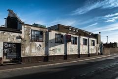 Norwich Backstreets (John Pettigrew) Tags: tamron d750 2470mm decay street norwich graffiti shadows urban spk derelict ones shook sunlight tags nikon industrial streetart east anglia norfolk