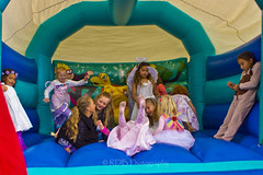 Bouncy Castle 4 (ArdieBeaPhotography) Tags: little girls fairy dresses halo wings pink laugh jump fall tumble tights puppy suit princess dress gauzy skirts kids children young small