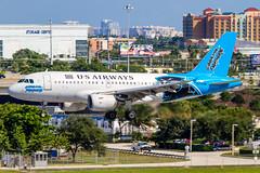 N717UW - Airbus A319-112 - US Airways (Bjoern Schmitt) Tags: n717uw airbus a319112 us airways carolinapanthers special colours kfll fll fort lauderdale arrival skyline houses landing airplane 319 a319 cn 1069