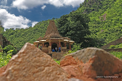Old Temple (Ashokkr Tyagi) Tags: old sky mountains green stone architecture clouds temple outdoor bulging canon70d