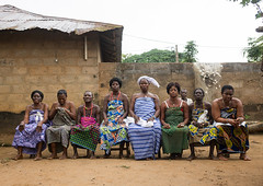 Benin, West Africa, Bopa, women sitting on bench in line during a voodoo ceremony (Eric Lafforgue) Tags: africa people color horizontal female togetherness women sitting adult religion ceremony womenonly believe westafrica ritual benin tradition devotee rite groupofpeople adultsonly voodoo rituals believer inarow vodun vodoun voudou bopa sorcery colourimage africanethnicity vodon  vudun    benin02710
