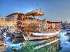 Colourful trader (Explore #189 29/9/15) (GillWilson) Tags: boat greece rhodes trader celebrityreflection