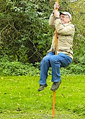 MAN UP A POLE (conespider) Tags: park uk trees england plants man male grass outside nikon outdoor hampshire pole gb berkshire 2015