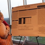 A woman looking at a capstone poster