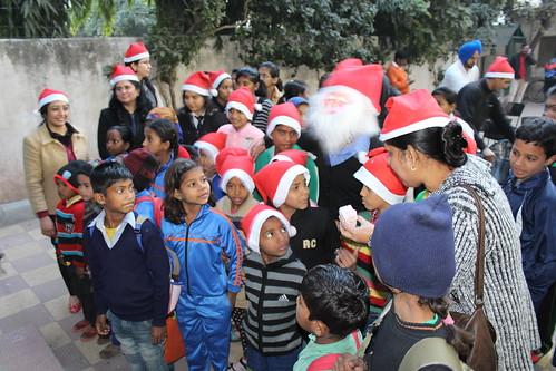 Children enjoying and celebrating Christmas with LinguaSoft team.