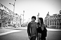Young Lovers (stimpsonjake) Tags: nikoncoolpixa 185mm streetphotography bucharest romania city candid blackandwhite bw monochrome young lovers boyfriend girlfriend walking romance couple