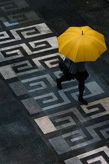 Girl with a Yellow Umbrella (camp_bell_) Tags: hong kong chinese university rain umbrella girl wet yellow grey gray tile concrete black pentax k10d 50mm pattern bright color