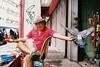Feeding Time (Yeow8) Tags: konicahexaraf konicafilmcamera agfavista200 agfafilm kualalumpur malaysia petalingstreet chinatown streetportrait streetphotography portrait portraiturephotography portraits portraiture pigeon birds filmphotography filmisnotdead