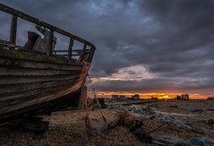 Casting the net (James Waghorn) Tags: sigma1020f456 autumn beach net dungeness topazclarity sunset pebbles boat wreck kent d7100 clouds light hut england desolate abandoned alone solitary moody