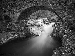 River Flow.. (LoneWolfA7ii) Tags: bw bnw black white river bridge feshiebridge feshie rocks flow water art old sony a7ii scotland monochrome blackandwhite stone long exposure