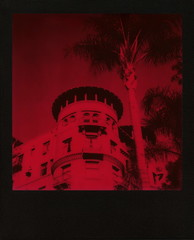 Red Castle Green (tobysx70) Tags: the impossible project tip polaroid slr680 frankenroid sx70 door rollers red black blackandred duochrome film for 600 type cameras instant blackframe impossaroid castle green raymond avenue pasadena california ca hotel apartments condo condominium 1893 1898 route 66 rt rte palm tree tower toby hancock photography