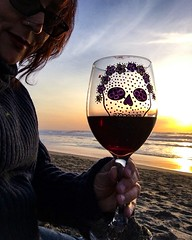 Happy Thanksgiving from the edge of the world. (BenitaMarquez) Tags: chiaroscuro beach mexican skull sugarskull thanksgiving horizon iphone bayarea northerncalifornia dusk water sand waves shadow silhouette glass wineglass woman outdoors ocean redwine shiraz wine usa california sanfrancisco sunset