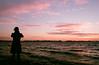 Sunset Shooter (Georgie_grrl) Tags: princeedwardcounty cottagechoir friendship music social friends roadtrip pentaxk1000 rikenon12828mm ontario sunset clouds beautiful light colour nikola friend silhouette