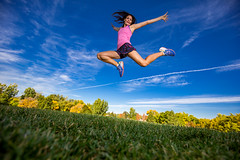 Flying high (Flickr_Rick) Tags: outside autumn bluesky woman brunette athletic beautiful strong jamie jump jumping jumpology